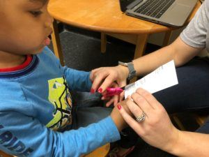 ABC Pediatric Therapy Cutting Paper using Fine Motor Skills