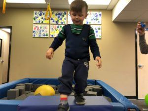 ABC Pediatric Therapy boy in weighted vest walking