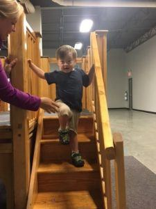 ABC Pediatric Therapy Boy climbing down stairs