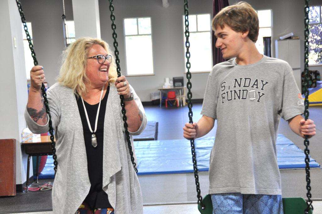 ABC Pediatric Therapy Teacher and Student on Swing